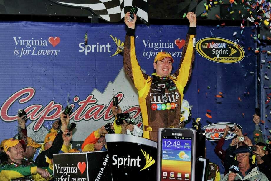 Kyle Busch celebrates winning the NASCAR Sprint Cup Series auto race at Richmond International Raceway in Richmond, Va., Saturday, April 28, 2012. (AP Photo/Clemment Britt) Photo: Clemment Britt, Associated Press / FRE -3440 AP CB