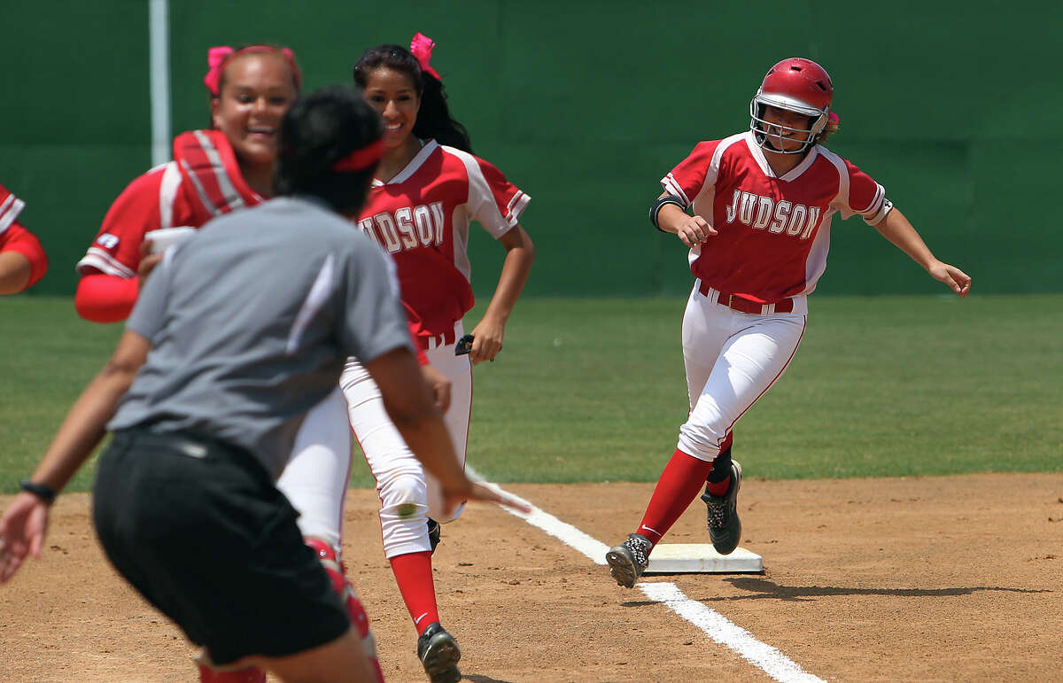 Judson's Nicole Shedd smiles as she rounds third after hitting a homer in the first inning of Game 2 against Johnson in bi-district softball playoffs on Saturday, Apr. 28, 2012. Judson defeated Johnson in three games to move on. Kin Man Hui/Express-News.