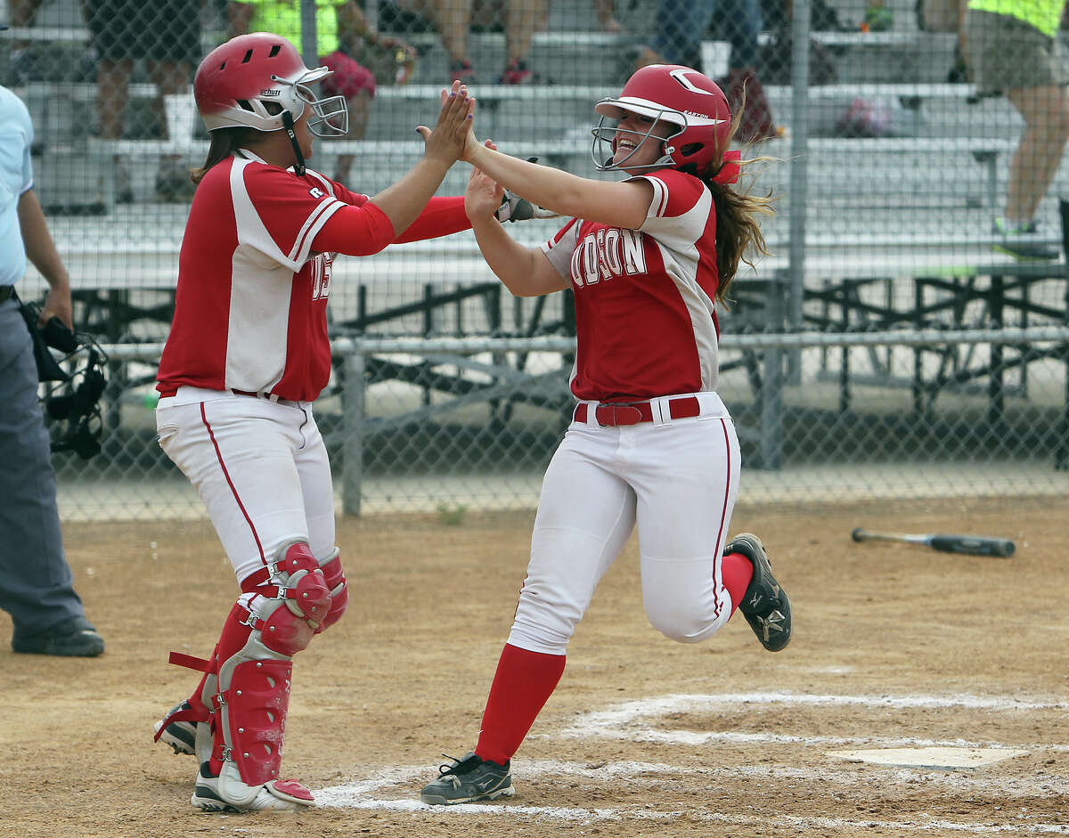 Judson's Samantha Hartsfield (right) gets congratulated by teammate Ariel Cana after scoring one of three runs in the third inning of the Game 3 against Johnson in bi-district softball playoffs on Saturday, Apr. 28, 2012. Judson defeated Johnson in three games to move on. Kin Man Hui/Express-News.