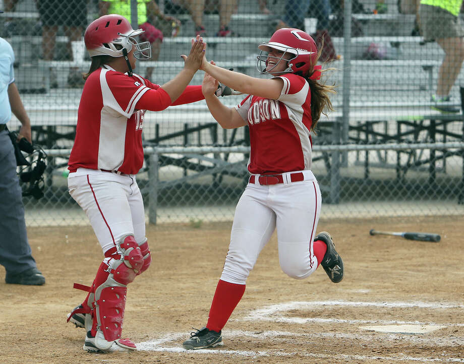Judson's Samantha Hartsfield (right) gets congratulated by teammate Ariel Cana after scoring one of three runs in the third inning of the Game 3 against Johnson in bi-district softball playoffs on Saturday, Apr. 28, 2012. Judson defeated Johnson in three games to move on. Kin Man Hui/Express-News. Photo: KIN MAN HUI, Express-News / ©2012 San Antonio Express-News