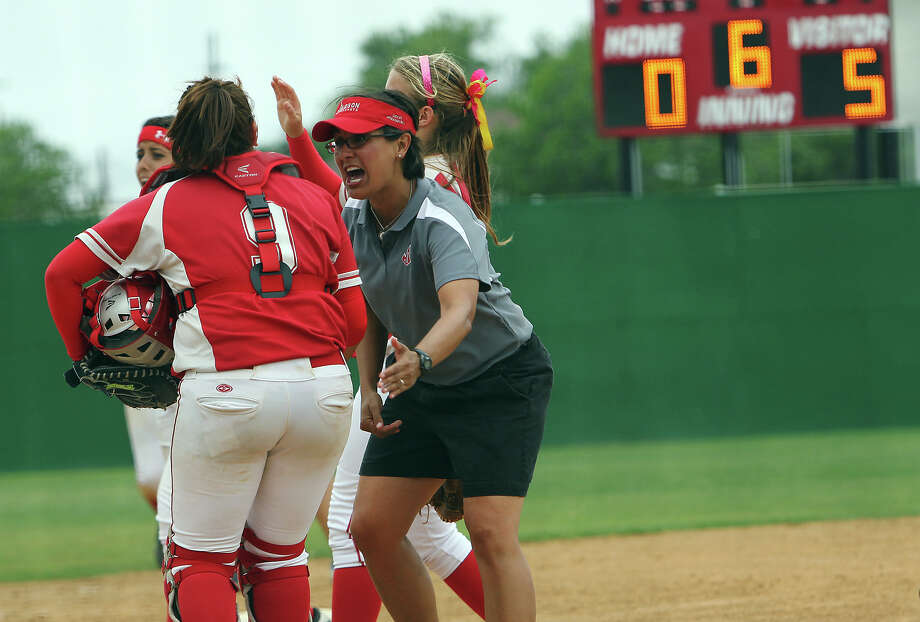 Judson softball coach Theresa Urbanovsky celebrates with her team after closing out the sixth inning against Johnson in bi-district softball playoffs on Saturday, Apr. 28, 2012. Judson defeated Johnson in three games to move on. Kin Man Hui/Express-News. Photo: KIN MAN HUI, Express-News / ©2012 San Antonio Express-News