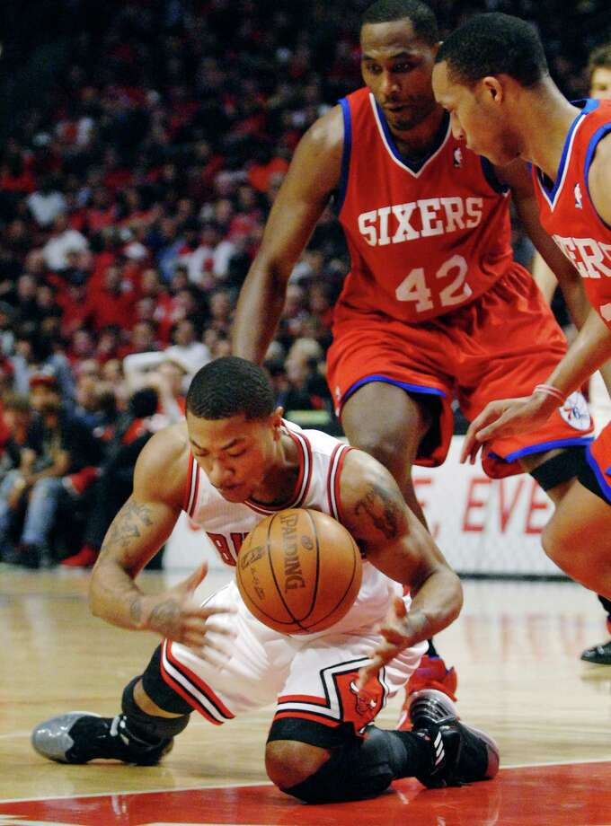 ee5e5308cab4 Chicago Bulls point guard Derrick Rose loses control of the ball as he  slips against Philadelphia