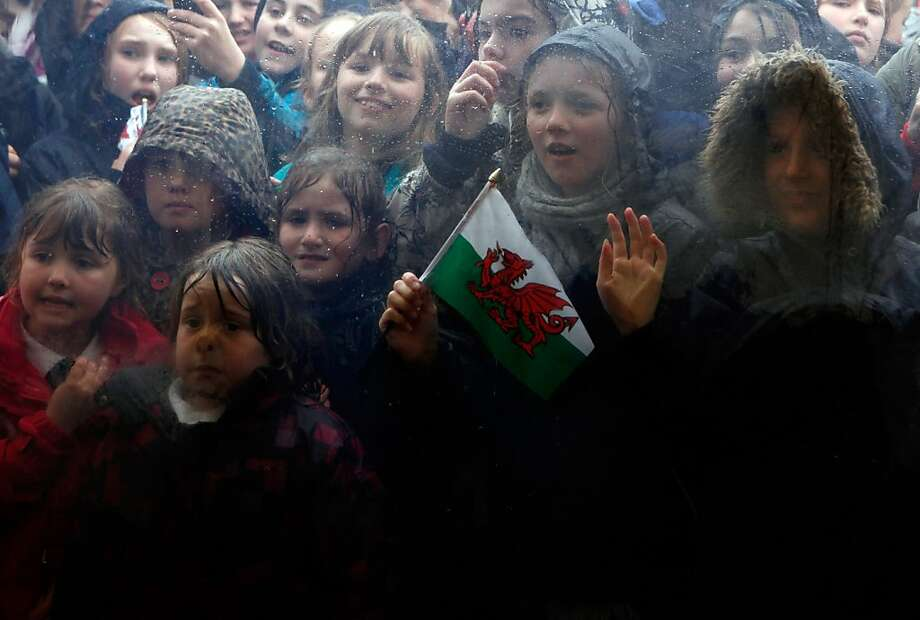CRICKHOWELL, WALES - APRIL 27:  Children look through a marquee window to watch as Queen Elizabeth II visits the Diamonds In The Park festival at Glanusk Park on April 27, 2012 near Crickhowell, South Wales. The Queen and Duke of Edinburgh are on a two day visit to Wales as part of their Diamond Jubilee tour of the country.  (Photo by Darren Staples - WPA Pool/Getty Images) Photo: WPA Pool, Getty Images