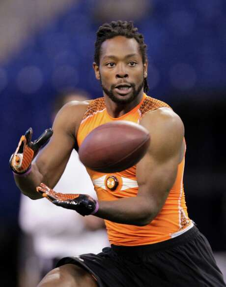 Michigan State receiver Keshawn Martin makes a catch as he runs a drill at the NFL football scouting combine in Indianapolis, Sunday, Feb. 26, 2012. (AP Photo/Michael Conroy) Photo: Michael Conroy / AP2012