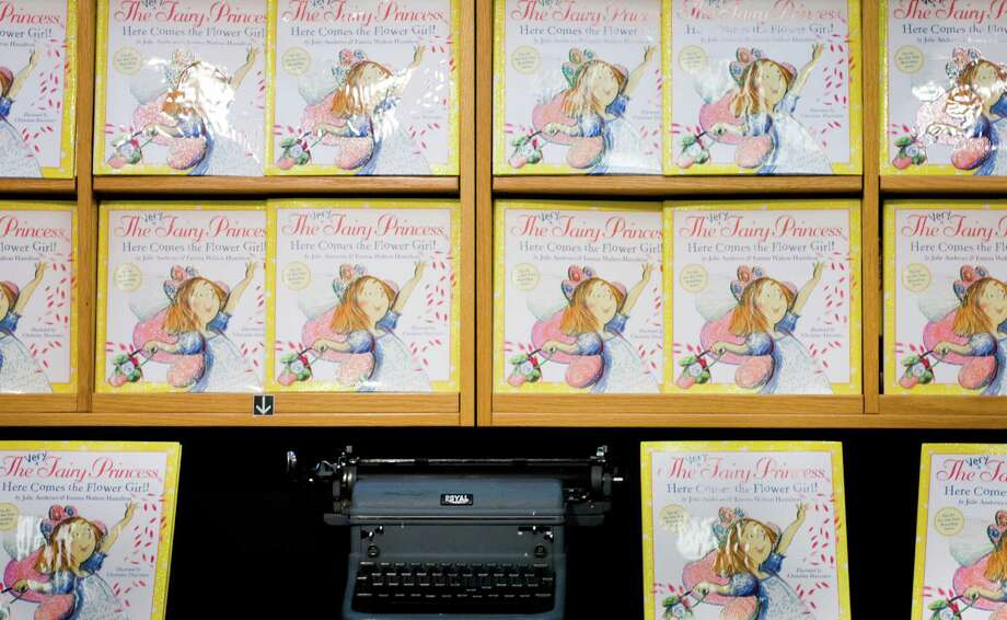 """Copies of """"The Very Fairy Princess: Here Comes the Flower Girl!"""" by Julie Andrews and her daughter, Emma Hamilton, line the shelves at the University Bookstore in Seattle before Andrews' book signing on Saturday, April 28, 2012. In addition to her acclaimed acting career, Andrews has been writing children's books for more than 40 years. Her book signing tour continues Sunday at Third Place Books in Bothell and the Lynwood Barnes & Noble; however, tickets to the signings are already sold out or very scarce. Photo: LINDSEY WASSON / SEATTLEPI.COM"""
