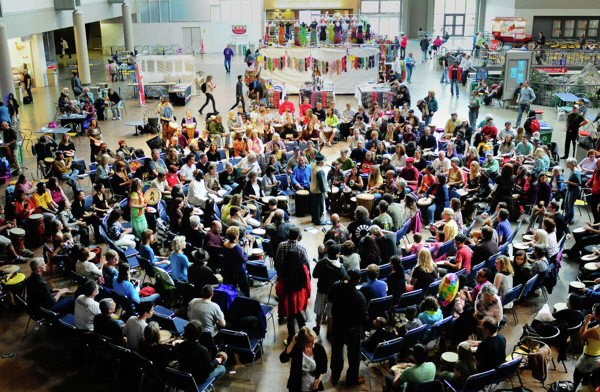 A few hundred people participate in a large drum circle in the Center House at the World Rhythm Festival at Seattle Center on Saturday, April 28, 2012.