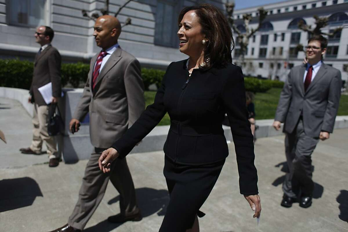 Kamala Harris walks with members of her staff from her office to a rally in front of San Francisco City Hall this month.