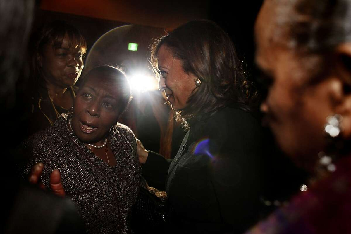 The attorney general speaks with former Richmond Mayor Irma Johnson after taking part in a forum this month at the Yerba Buena Center for the Arts in San Francisco. Harris was raised by her mother in the East Bay.