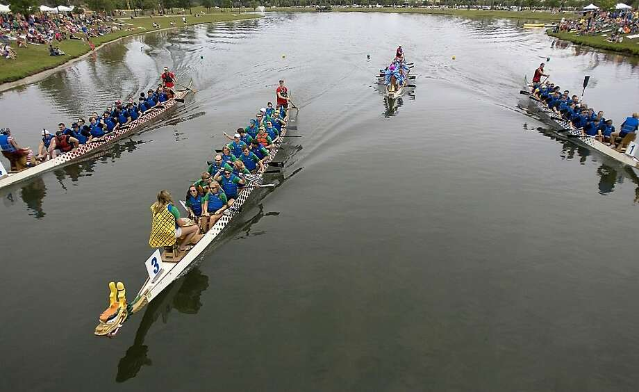 A variety of teams compete in the annual Ground Zero Dragon Boat Festival is underway at The Market Common on Saturday, April 28, 2012, in Myrtle Beach, S.C. (AP Photo/The Sun News, Janet Blackmon Morgan) Photo: Janet Blackmon Morgan, Associated Press
