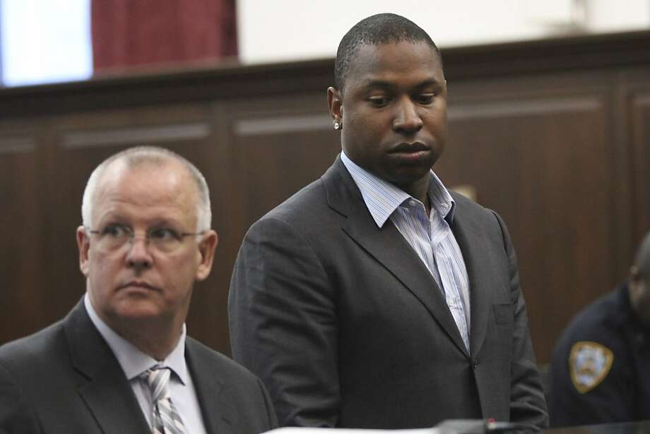 Detroit Tigers left fielder Delmon Young, right, accompanied by his attorney Daniel J.Ollen, is arraigned in Manhattan criminal court, Friday, April 27, 2012 in New York. Police say Young got into a fight with a group of men early Friday outside the team's midtown Manhattan hotel and yelled anti-Semitic epithets. (AP Photo/Mary Altaffer) Photo: Mary Altaffer, Associated Press