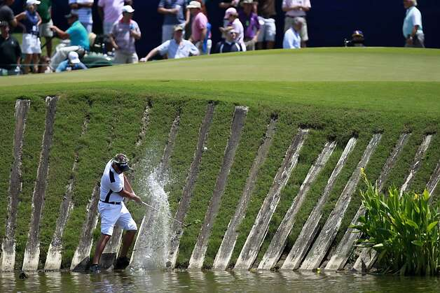 Daniel Chopra, of Sweden, hits out of a lagoon back onto the ninth green during the third round of the Zurich Classic golf tournament at TPC Louisiana in Avondale, La., Saturday, April 28, 2012. Photo: Gerald Herbert, Associated Press