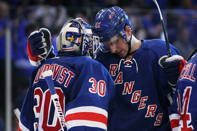 Henrik Lundqvist #30 and Artem Anisimov #42 of the New York Rangers celebrate their 3 to 1 win over the Washington Capitals in Game One of the Eastern Conference Semifinals during the 2012 NHL Stanley Cup Playoffs at Madison Square Garden on April 28, 2012 in New York City. Photo: Bruce Bennett, Getty Images