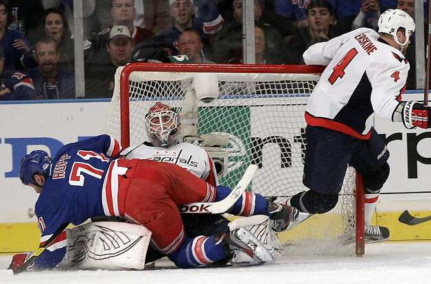 New York Rangers' Mike Rupp (71) collides with Washington Capitals goalie Braden Holtby during the first period of Game 1 in the second round of the NHL hockey Stanley Cup playoffs Saturday, April 28, 2012, in New York. Photo: Frank Franklin II, Associated Press