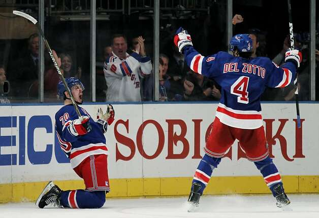 Chris Kreider #20 celebrates his third period goal with teammate Michael Del Zotto #4 of the New York Rangers in Game One of the Eastern Conference Semifinals against the Washington Capitals during the 2012 NHL Stanley Cup Playoffs at Madison Square Garden on April 28, 2012 in New York City. Photo: Bruce Bennett, Getty Images