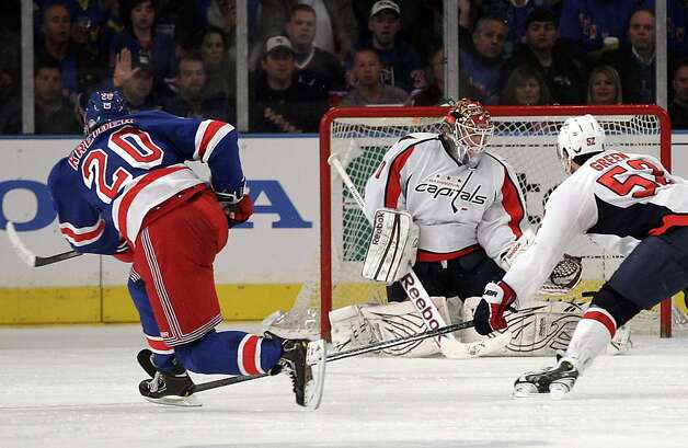 New York Rangers' Chris Kreider (20) shoots the puck past Washington Capitals goalie Braden Holtby (70) for a goal as teammate Mike Green (52) looks on during the third period of Game 1 in the second round of the NHL hockey Stanley Cup playoffs, Saturday, April 28, 2012, in New York. The Rangers won the game 3-1. Photo: Frank Franklin II, Associated Press