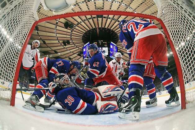 Henrik Lundqvist #30 of the New York Rangers falls on the ice in front of goal goal during the third period of Game One of the Eastern Conference Semifinals against the Washington Capitals during the 2012 NHL Stanley Cup Playoffs at Madison Square Garden on April 28, 2012 in New York City. Photo: Bruce Bennett, Getty Images