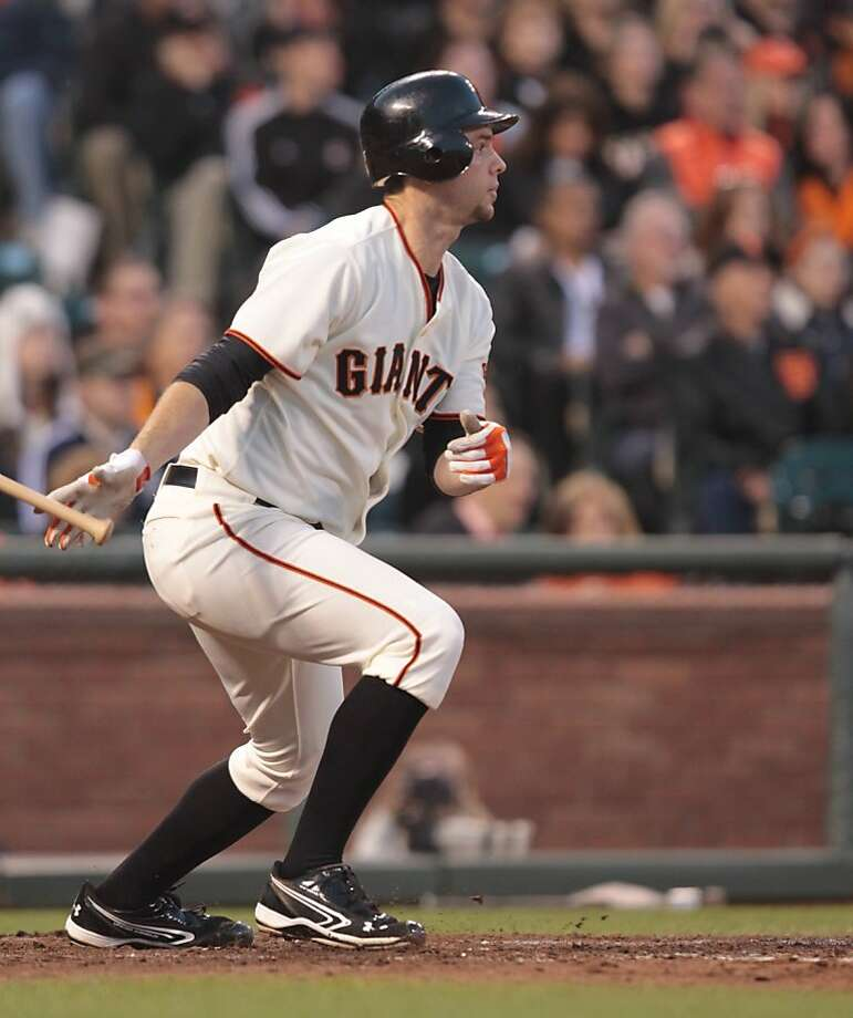 The Giants' Brandon Belt drove in two RBIs with this hit in the seventh inning against the Padres at AT&T Park on Saturday, April 28, 2012, in San Francisco. The Giants won 2-1. Photo: Mathew Sumner, Special To The Chronicle