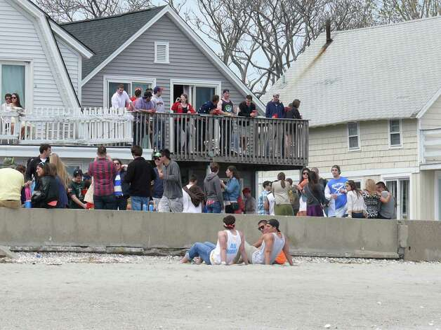 Although several hundred students attended Saturday's Clam Jam, which began in the morning and broke up after 5 p.m., corwds were smaller and tightly controlled by police and members of the Lantern Point Association. Photo: Genevieve Reilly / Fairfield Citizen