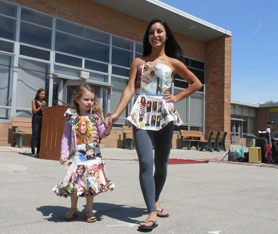 "Young models show outfits made from magazine pages and covers,and modeled for the ""Trashy Fashions"" feature Saturday at Fairfield's Earth Day Celebration at Fairfield Warde High School. Photo: Mike Lauterborn / Fairfield Citizen contributed"