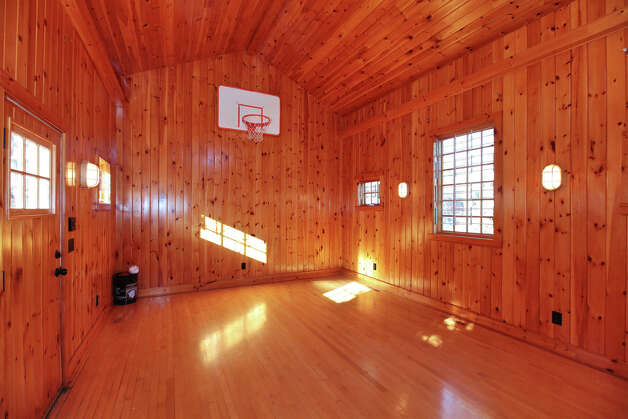 Coleytown colonial offers two barns plenty of recreation for Building a half court basketball court