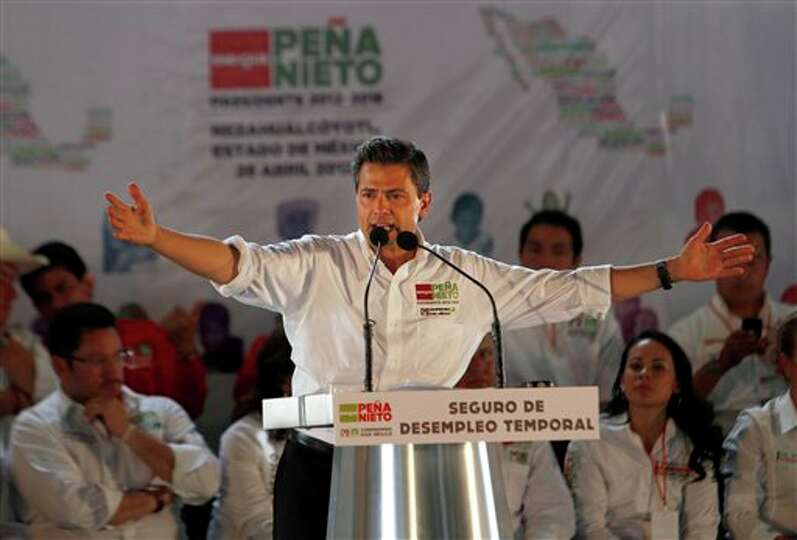 Enrique Pena Nieto, presidential candidate for the Institutional Revolutionary Party (PRI), speaks t