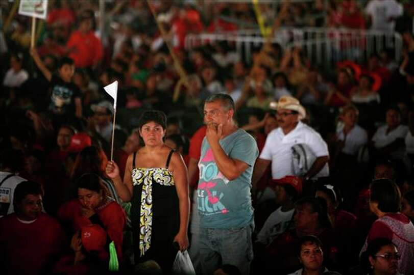 People attend a campaign rally for presidential candidate Enrique Pena Nieto, of the Institutional R