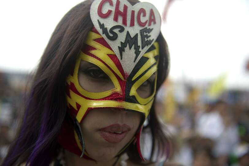 A masked supporters of Mexican presidential candidate for the leftist coalition Progressive Movement