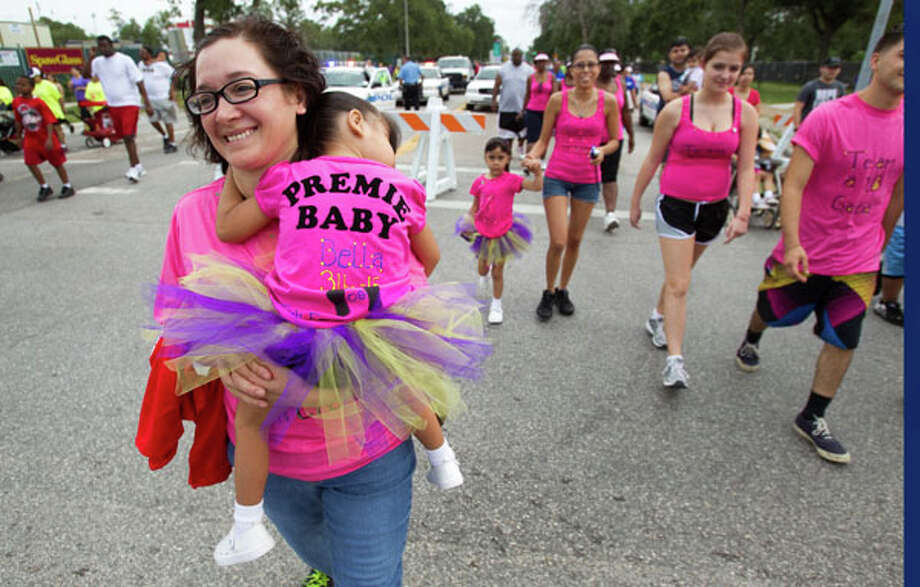 Gemma Garcia, carries her granddaughter, Bella Garcia during the Houston March for Babies Sunday, April 29, 2012, in Houston. Thousands of walkers took to the streets around the University of Houston campus to raise money for the March of Dimes, supporting lifesaving research and community programs that help mothers have healthy, full-term pregnancies and strong, healthy babies. ( Brett Coomer / Houston Chronicle ) Photo: Brett Coomer, Houston Chronicle / © 2012 Houston Chronicle