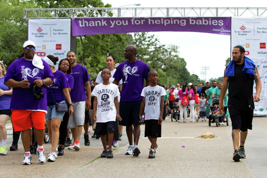 Walkers take to the streets during the Houston March for Babies Sunday, April 29, 2012, in Houston. Thousands of walkers took to the streets around the University of Houston campus to raise money for the March of Dimes, supporting lifesaving research and community programs that help mothers have healthy, full-term pregnancies and strong, healthy babies. ( Brett Coomer / Houston Chronicle ) Photo: Brett Coomer, Houston Chronicle / © 2012 Houston Chronicle
