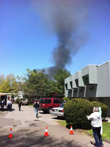 Wilton EMS workers respond to a fire at Wilton Crest condominiums in Wilton, Conn., Sunday, April 30, 2012. Photo: David McCumber/Staff Photo