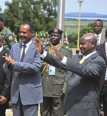 Uganda's President Yoweri Museveni , right,  and his Eritrean counterpart Isaias Afewerki wave, Tuesday, Aug. 16, 2011, as Afewerki arrived in Uganda for a three day visit. (AP Photo/Ronald Kabuubi) Photo: Ronald Kabuubi, AP