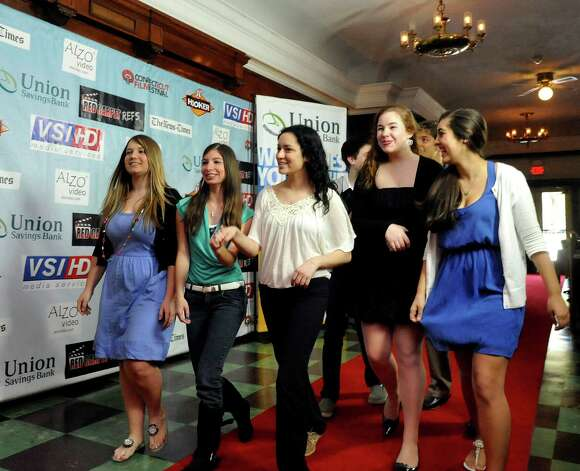 "Area high school filmmakers walk down the red carpet at the Palace theater in Danbury for the screening of their short films in the ""Show us your shorts"" competition as part of the Connecticut Film Festival Sunday, April 29, 2012. Photo: Michael Duffy / The News-Times"