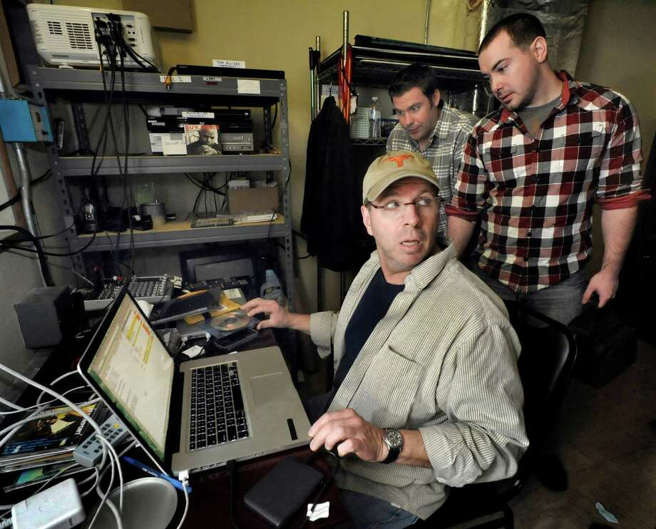 """Tom Carruthers loads a film by Paul Rivot and Brendan Major, right, at the Palace theater in Danbury for the screening of the """"Show us your shorts"""" competition as part of the Connecticut Film Festival Sunday, April 29, 2012. Photo: Michael Duffy / The News-Times"""