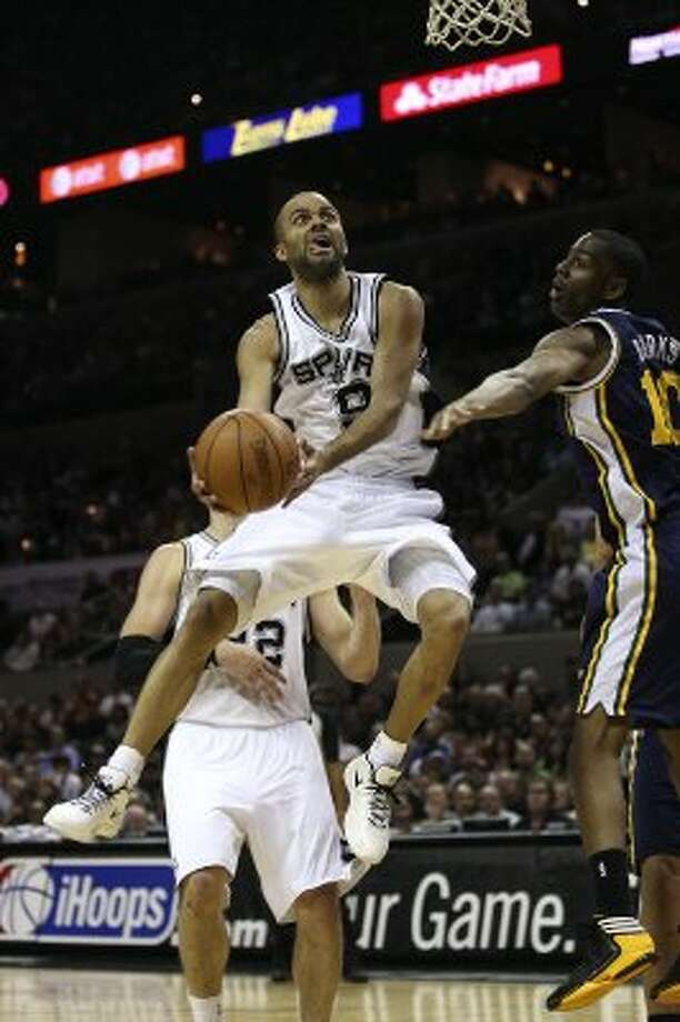 Spurs guard Tony Parker goes for two against Utah Jazz guard Alec Burk during the first half of game one of the Western Conference first round at the AT&T Center, Sunday, April 29, 2012. Jerry Lara/San Antonio Express-News (Jerry Lara / San Antonio Express-News)
