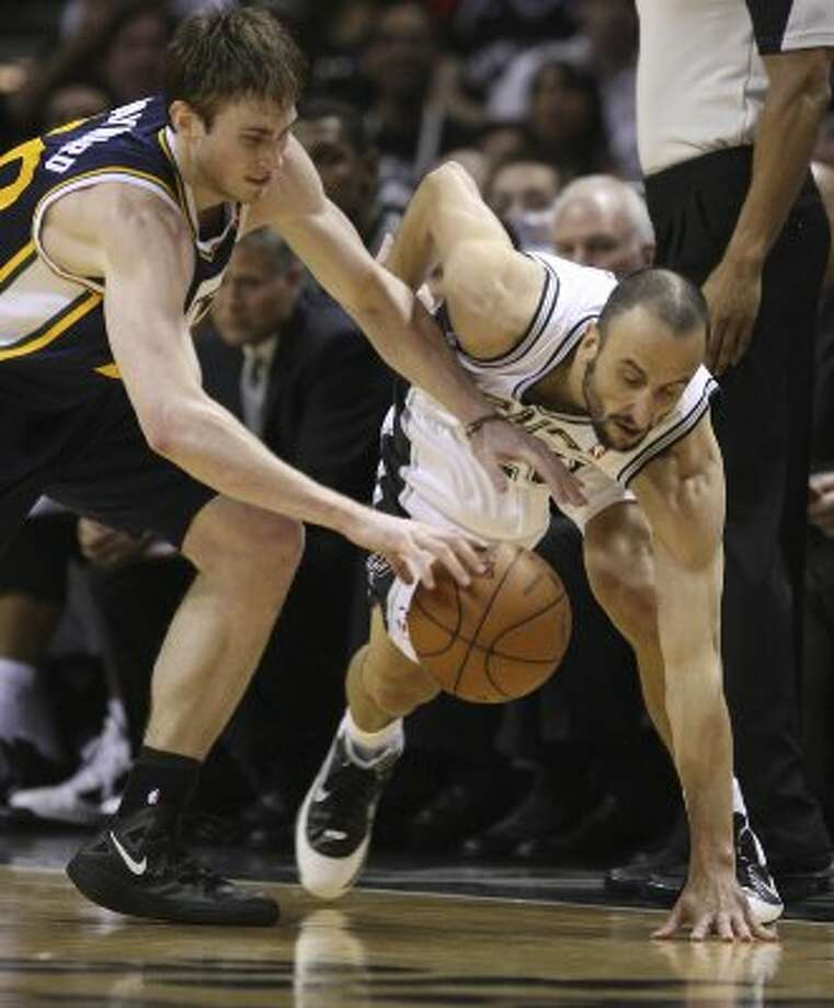 Spurs guard Manu Ginobili tries to steal the ball from Utah Jazz forward Gordon Hayward during the first half of game one of the Western Conference first round at the AT&T Center, Sunday, April 29, 2012. Jerry Lara/San Antonio Express-News (Jerry Lara / San Antonio Express-News)