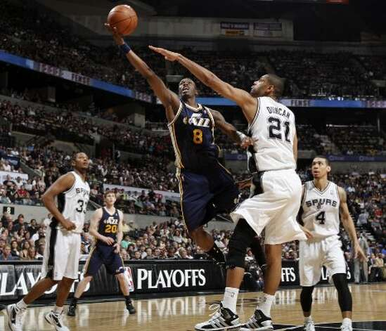 Utah Jazz Josh Howard shoots around the Spurs' Tim Duncan during first half action of Game 1 of the Western Conference first round Sunday April 29, 2012 at the AT&T Center. EDWARD A. ORNELAS/SAN ANTONIO EXPRESS-NEWS (EDWARD A. ORNELAS / SAN ANTONIO EXPRESS-NEWS)