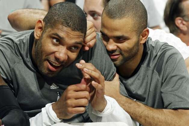 Spurs Tim Duncan (left) and Tony Parker joke on the bench near the end of Game 1 of the Western Conference first round with the Utah Jazz  Sunday April 29, 2012 at the AT&T Center. The Spurs won 106-91.  EDWARD A. ORNELAS/SAN ANTONIO EXPRESS-NEWS (EDWARD A. ORNELAS / SAN ANTONIO EXPRESS-NEWS)