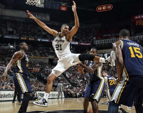 The Spurs' Tim Duncan loses control of the ball between Utah Jazz Al Jefferson (from left), Paul Millsap, and Derrick Favors during second half action of Game 1 of the Western Conference first round Sunday April 29, 2012 at the AT&T Center. The Spurs won 106-91.  EDWARD A. ORNELAS/SAN ANTONIO EXPRESS-NEWS (EDWARD A. ORNELAS / SAN ANTONIO EXPRESS-NEWS)