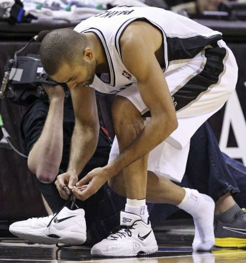 Spurs guard Tony Parker puts on his shoe during first half action of Game 1 of the Western Conference first round against the Utah Jazz Sunday April 29, 2012 at the AT&T Center. EDWARD A. ORNELAS/SAN ANTONIO EXPRESS-NEWS (EDWARD A. ORNELAS / SAN ANTONIO EXPRESS-NEWS)
