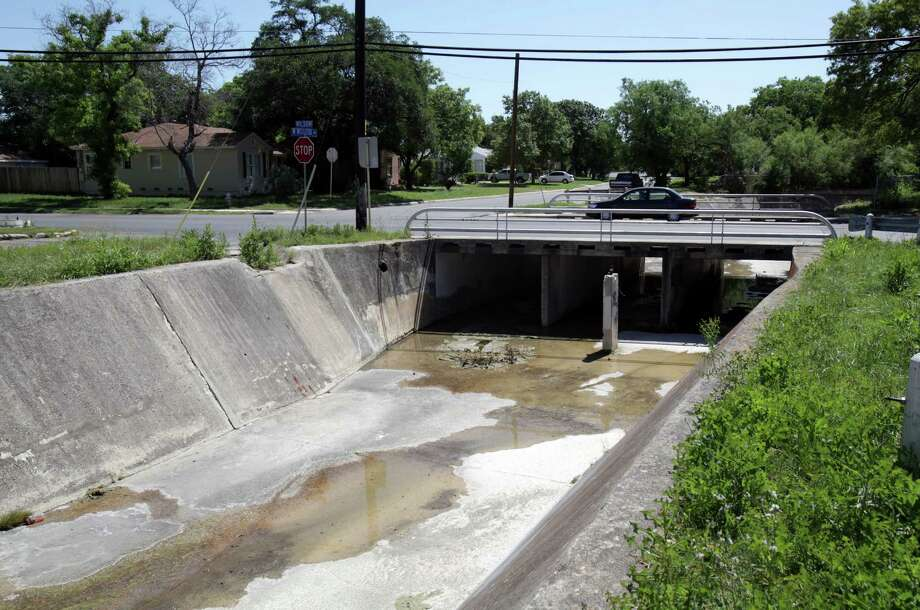 The costliest flood-control project in Proposition 2 of the city's bond issue is a $24.6 million proposal for work upstream of Woodlawn Lake. The Seeling Channel, shown at West Mistletoe and Wilson, would be rebuilt as part of the project. Photo: BOB OWEN, San Antonio Express-News / © 2012 San Antonio Express-News