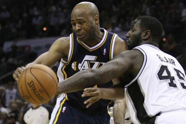 The Spurs' DeJuan Blair strips the ball away from Utah Jazz Jamaal Tinsley during the second half of game one of the Western Conference first round at the AT&T Center, Sunday, April 29, 2012. The Spurs won 106-91 to lead the series 1-0. Jerry Lara/San Antonio Express-News (Jerry Lara / San Antonio Express-News)