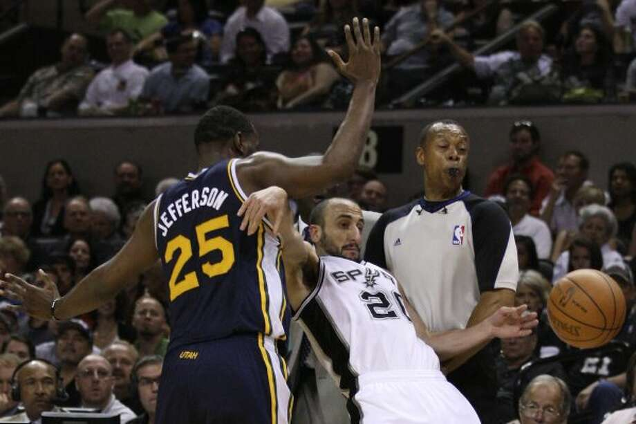 The Spurs' Manu Ginobili is fouled by Utah Jazz Al Jefferson as official Rodney Mott tries to gets out of the way during the first half of game one of the Western Conference first round at the AT&T Center, Sunday, April 29, 2012. Jerry Lara/San Antonio Express-News (Jerry Lara / San Antonio Express-News)