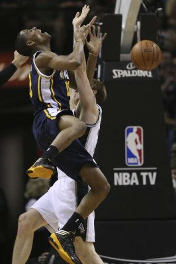 The Spurs' Matt Bonner gets a foul while attempting to stop Utah Jazz Alec Burks during the first half of game one of the Western Conference first round at the AT&T Center, Sunday, April 29, 2012. Jerry Lara/San Antonio Express-News (Jerry Lara / San Antonio Express-News)