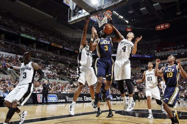 FOR SPORTS - San Antonio Spurs Boris Diaw and Danny Green defend Utah Jazz DeMarre Carroll during first half action of Game 1 of the Western Conference first round Sunday April 29, 2012 at the AT&T Center. (PHOTO BY EDWARD A. ORNELAS/SAN ANTONIO EXPRESS-NEWS) (EDWARD A. ORNELAS / SAN ANTONIO EXPRESS-NEWS)