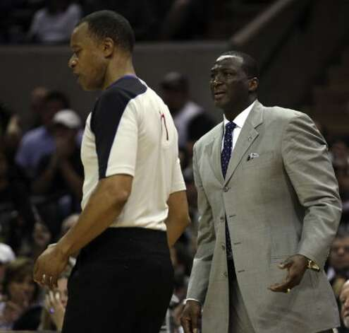 Jazz coach Tyrone Corbin tries to appeal a call with official Rodney Mott during the second half of game one of the Western Conference first round at the AT&T Center, Sunday, April 29, 2012. The Spurs won 106-91 to lead the series 1-0. Jerry Lara/San Antonio Express-News (Jerry Lara / San Antonio Express-News)