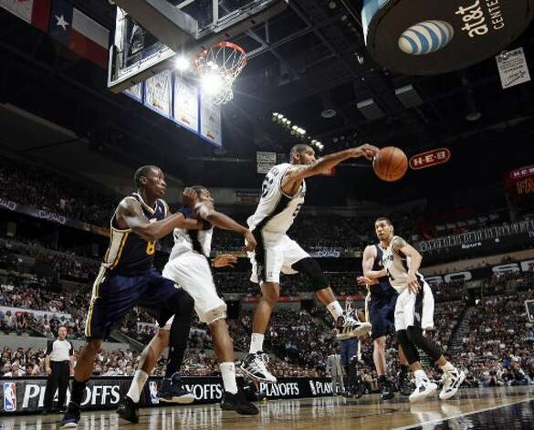 The Spurs' Tim Duncan grabs for a rebound during first half action of Game 1 of the Western Conference first round against the Utah Jazz Sunday April 29, 2012 at the AT&T Center. EDWARD A. ORNELAS/SAN ANTONIO EXPRESS-NEWS (EDWARD A. ORNELAS / SAN ANTONIO EXPRESS-NEWS)