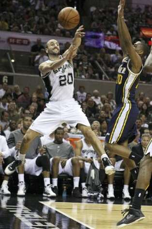 The  Spurs' Manu Ginobili saves the ball from going out of bounds  during second half action of Game 1 of the Western Conference first round against the Utah Jazz  Sunday April 29, 2012 at the AT&T Center. The Spurs won 106-91.  EDWARD A. ORNELAS/SAN ANTONIO EXPRESS-NEWS (EDWARD A. ORNELAS / SAN ANTONIO EXPRESS-NEWS)
