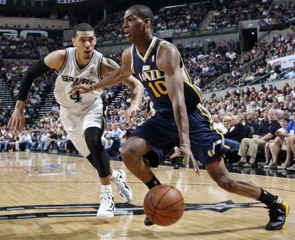 The Spurs' Danny Green defends Utah Jazz Alec Burks during first half action of Game 1 of the Western Conference first round Sunday April 29, 2012 at the AT&T Center. EDWARD A. ORNELAS/SAN ANTONIO EXPRESS-NEWS (EDWARD A. ORNELAS / SAN ANTONIO EXPRESS-NEWS)