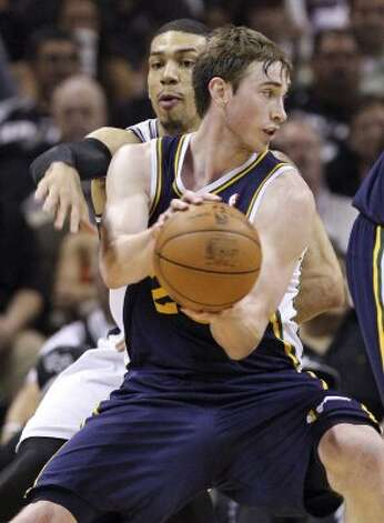 The Spurs' Danny Green defends Utah Jazz Gordon Hayward during second half action of Game 1 of the Western Conference first round Sunday April 29, 2012 at the AT&T Center. The Spurs won 106-91.  EDWARD A. ORNELAS/SAN ANTONIO EXPRESS-NEWS (EDWARD A. ORNELAS / SAN ANTONIO EXPRESS-NEWS)