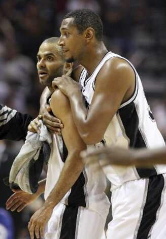 The Spurs' Tony Parker is hugged by teammate Boris Diaw during a timeout in second half action of Game 1 of the Western Conference first round against the Utah Jazz Sunday April 29, 2012 at the AT&T Center. The Spurs won 106-91.  EDWARD A. ORNELAS/SAN ANTONIO EXPRESS-NEWS (EDWARD A. ORNELAS / SAN ANTONIO EXPRESS-NEWS)